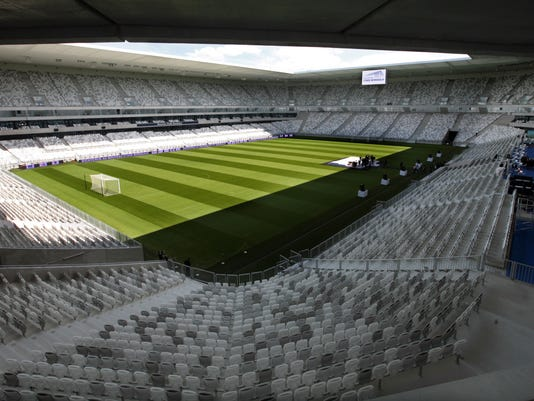 View of the brand new Bordeaux stadium, in Bordeaux, southwestern France, Monday May, 18, 2015. The stadium will host five games at the Euro 2016 soccer tournament, including one quarterfinal match. The stadium, which has a floating roof supported by thin poles, will have a capacity of 40,000 for the tournament. (AP Photo/Bob Edme)