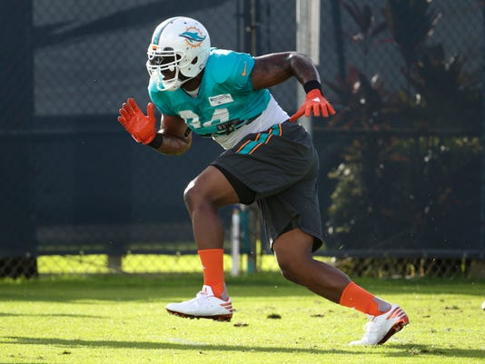 FILE - In this Aug. 15, 2016 file photo, Miami Dolphins defensive end Mario Williams runs drills, during practice at NFL football training camp in Davie, Fla. Williams makes in his debut with Miami on Sunday, Sept. 11 when the Dolphins play the the Seattle Seahawks.  (AP Photo/Lynne Sladky, File)