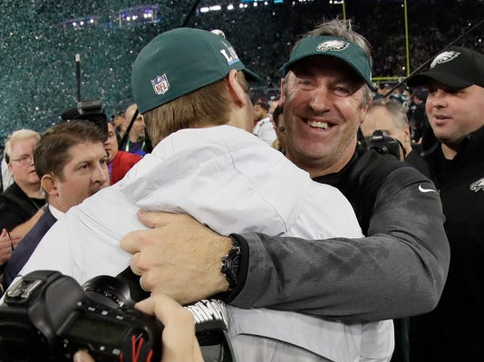 Philadelphia Eagles head coach Doug Pederson, right, celebrates with Carson Wentz after the NFL Super Bowl 52 football game against the New England Patriots Sunday, Feb. 4, 2018, in Minneapolis. The Eagles won 41-33. (AP Photo/Mark Humphrey)