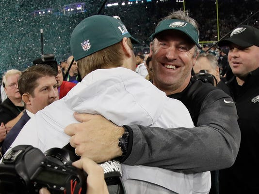 Philadelphia Eagles head coach Doug Pederson, right, celebrates with Carson Wentz after the NFL Super Bowl 52 football game against the New England Patriots Sunday, Feb. 4, 2018, in Minneapolis. The Eagles won 41-33. (AP Photo/Mark Humphrey)