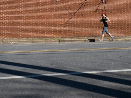 Marie Beck on mile 17 of the Knoxville Marathon through