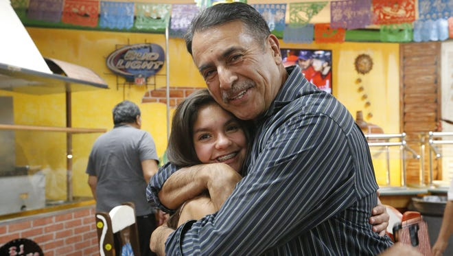 """District 7 City Council candidate Enrique """"Henry"""" Rivera embraces his niece, Amaryllis Rubalcaba, 14, after hearing a vote count Saturday night that showed him ahead of incumbent Lily Limón. He went on to win the election."""