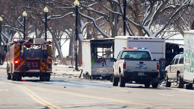 Police and fire vehicles are seen along 15th Street NW in Washington near a vendor cart that caught on fire on March 7, 2015.
