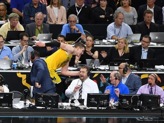 Michigan Wolverines forward Moritz Wagner (13) falls