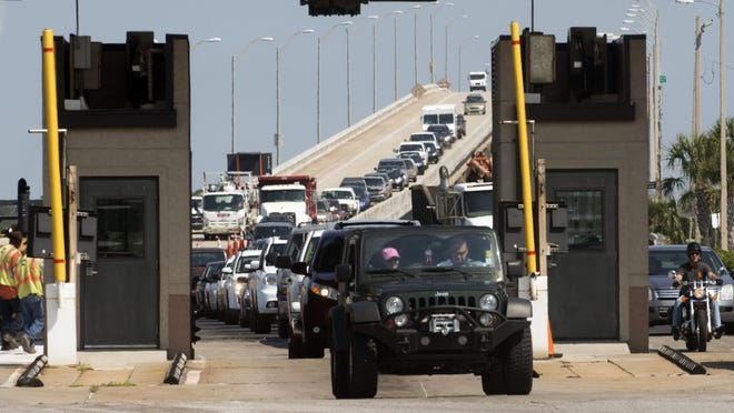 Traffic backs up at the toll booth on the Bob Sikes Bridge in this file photo.