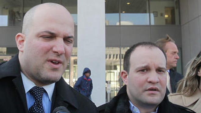 Brothers Jonathan Russo and Michael Russo comment on the jury's decision to award the family $2 million in damages from the city of White Plains outside of the County Courthouse in White Plains on Feb. 10, 2014. Concetta Russo-Carriero was stabbed to death in a parking garage near the Galleria in 2005.
