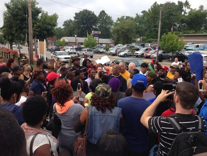 A peaceful protest took place at the Ferguson Police Department Sunday afternoon.  The protest was hours before the looting and violence occurred in Ferguson Sunday evening and into Monday morning.