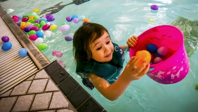 Kindle Radice wears her life jacket and gathers eggs at Murfreesboro Parks & Rec.'s annual Underwater Easter Egg Hunt at the indoor pool at Patterson Park Community Center.