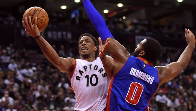 Oct 26, 2016; Toronto, Ontario, CAN; Toronto Raptors guard DeMar DeRozan goes up for a basket past Detroit Pistons center Andre Drummond in the second half at Air Canada Centre.
