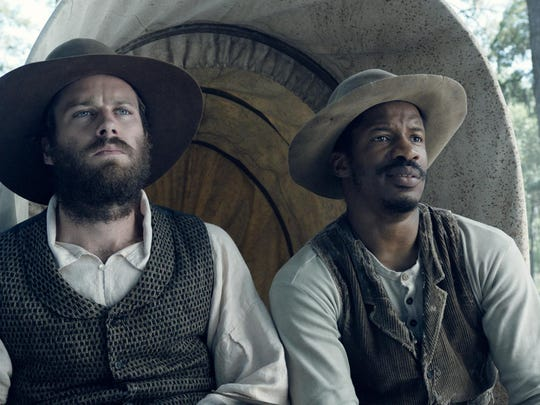 "Armie Hammer portrays Samuel Turner, left, and Nate Parker portrays Nat Turner in a scene from ""The Birth of a Nation."""