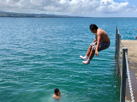 Kristian Yamashiro, 16, jumps into the ocean off a