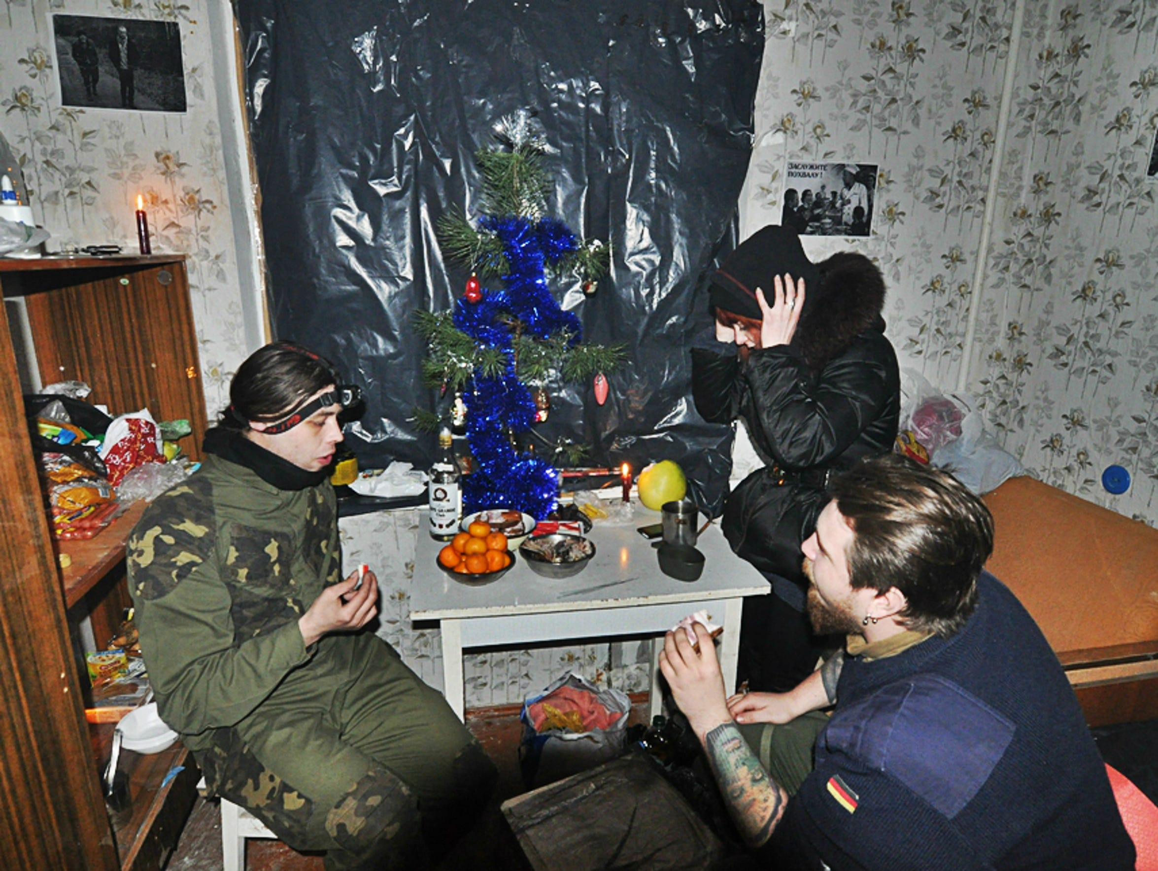 Kirill Stepanets, left, in an abandoned apartment in