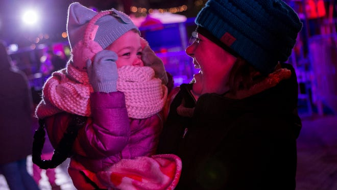 Heather Preville of Murfreesboro laughs with her daughter Amelia, 3, during the Jack Daniel's Music City Midnight: New Year's Eve held at Bicentennial Capitol Mall State Park in Nashville, Tenn., Sunday, Dec. 31, 2017.