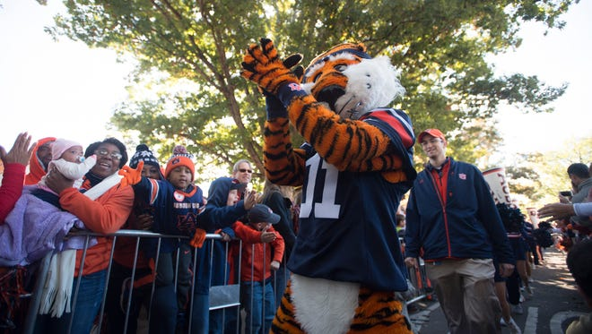 Auburn claps during Tiger Walk before the the NCAA football game between Auburn Tigers and Georgia on Saturday, Nov. 14, 2015, in Auburn, Ala.