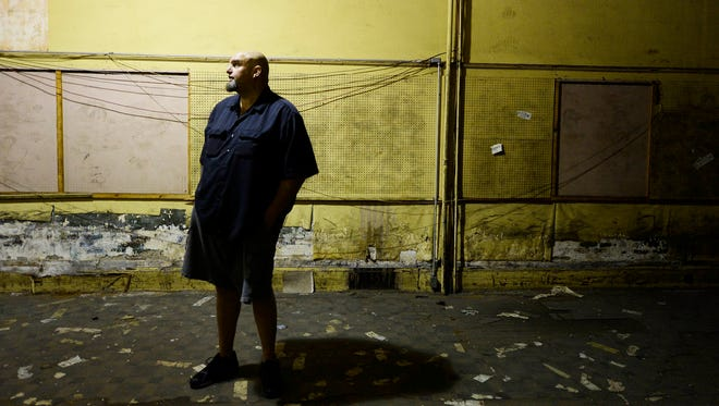 John Fetterman stands in a space being donated to his charity, Braddock Redux, in Braddock, Pa., Tuesday, December 22, 2015.