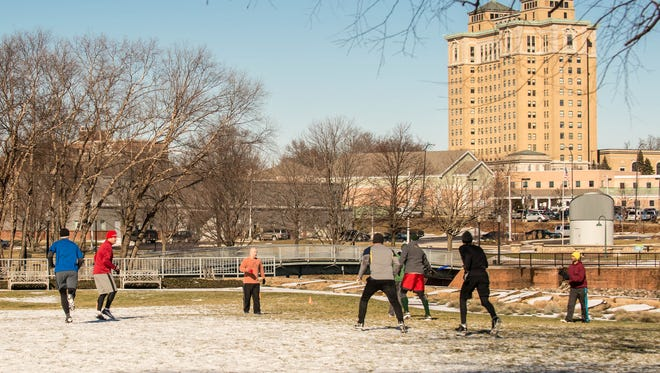 Kellogg's workers play a daily game of ultimate in downtown Battle Creek during their lunch break.