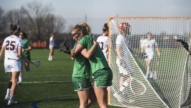 York College's Melissa Meehling is congratulated by teammate Allison Kolacy, right, after Meehling scored against Gettysburg College on Wednesday at Gettysburg College's Clark Field.