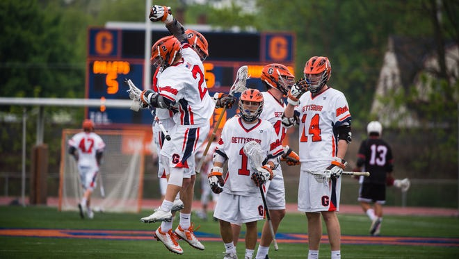 Gettysburg's Justin McBride (2) celebrates with teammate Paul Werner after Gettysburg scored against Lynchburg College on Wednesday May 11, 2016 at Musselman Stadium at Gettysburg College in the opening round of the NCAA men's lacrosse championship.