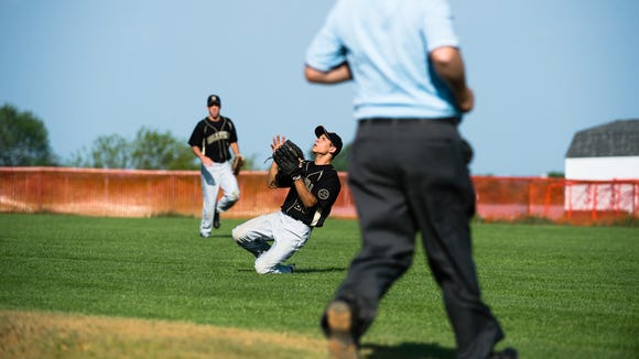 Biglerville's Chris Runk drops down to catch an outfield ball from Delone on Tuesday May 24, 2016 at Biglerville High School during the first round of the District 3 baseball tournament. Biglerville defeated Delone and moves on.