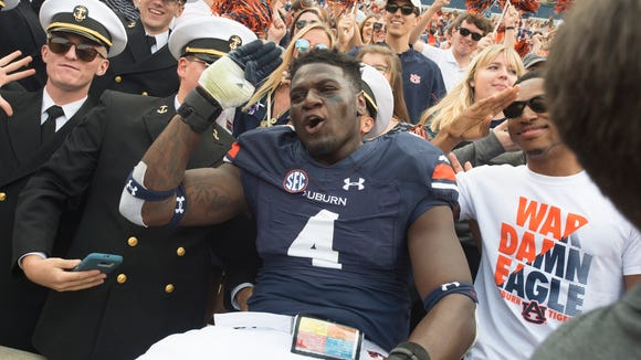 Auburn linebacker Jeff Holland (4) and the Tigers have gone from flying high after winning six games in a row to sinking after last week's loss at Georgia.