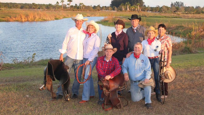 Getting ready for the third annual Cattlemen's Dance to benefit the Sunrise Theatre Foundation are, (kneeling) Milt Koster, Paul Passo and (standing) Kent & Sandi Leonard, Kathy McClure, Michael Goforth, Sue Passo and Nancy Archer.