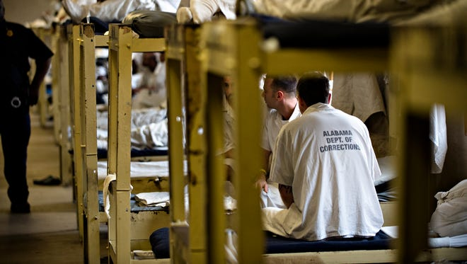 Inmates sit on their bunks at Draper Correction Facility in Elmore County, Ala., on Monday, Feb. 6, 2017. Draper Correction Facility is the oldest correction facility in the state of Alabama. The prison opened in 1939. It is currently housing 1059 prisoners, Draper's designed capacity is 656.