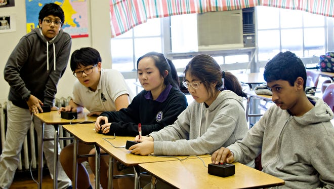 From left, Saad khan, 12, Chris Yang, 13, Adela Sheng, 13, Jenny Baek, 14, and Anirudh Harishankar, 14, listen to a question during Academic Bowl practice with the rest of their team on Wednesday, March 8, 2017, at Baldwin Magnet school in Montgomery, Ala. The Baldwin squad defeated Huntsville's Liberty Middle School in the finals of the 2016-2017 state championship at Hoover High School in February. The team is scheduled to compete in the National Academic Bowl in Dallas, Texas, on May 13, 2017.