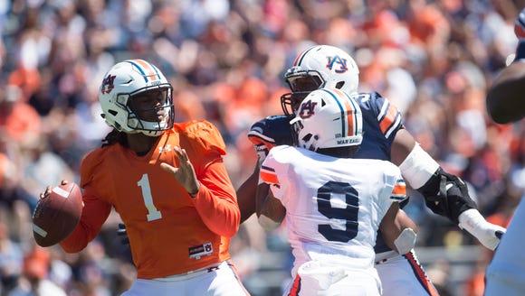 Auburn quarterback Woody Barrett (1) looks to throw