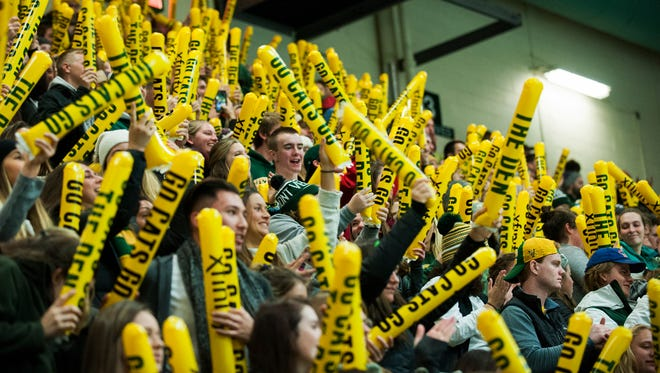 Fans cheer for the team during the men's hockey game between the Boston College Eagles and the Vermont Catamounts at Gutterson Field House on Friday night November 10, 2017 in Burlington.