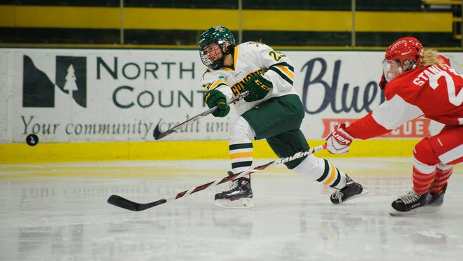 Catamount forward Alyssa Holmes (25) shoots the puck during the women's hockey game between the Boston Terriers and the Vermont Catamounts at Gutterson Fieldhouse on Friday night November 17, 2017 in Burlington.