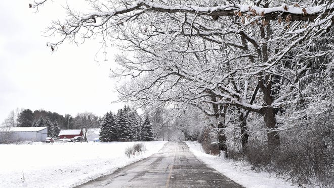 Snow and very cold temperatures could leave roads slick during the morning commute Tuesday in the Lansing area.