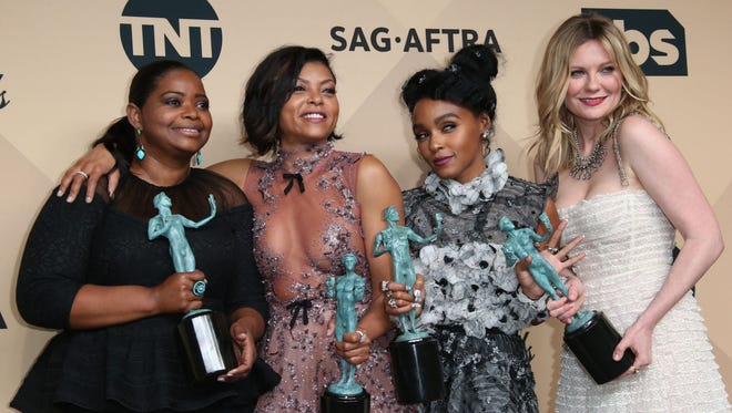Octavia Spencer, Taraji P. Henson, Janelle Monae and Kirstin Dunst post with their Screen Actors Guild trophies Sunday.