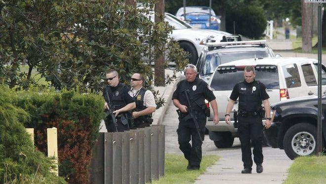 Police respond to a home on West Packer Avenue in Sayre on July 31. After more than 10 hours, the standoff came to an end when they found the resident, Justin Holloway, at a nearby fire department.