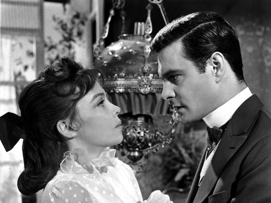 Louis Jourdan, right, with Leslie Caron in 1958's 'Gigi,' which won best picture at the Academy Awards.