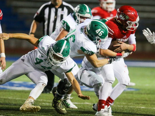 Wall's Steve Watts (46) tackles Jim Ned's Coalby Rives during the Class 3A Division I area playoffs Friday, Nov. 24, 2017, at San Angelo Stadium.