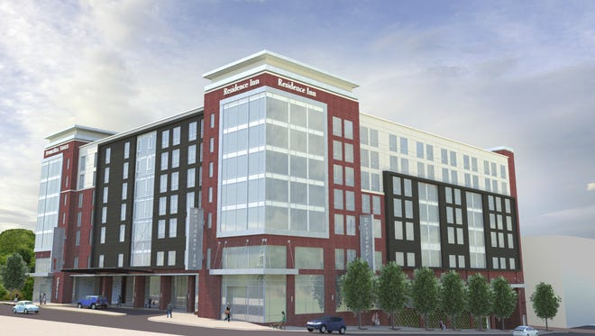A rendering of the Residence Inn and SpringHill Suites hotel under construction on East Washington and Spring streets.