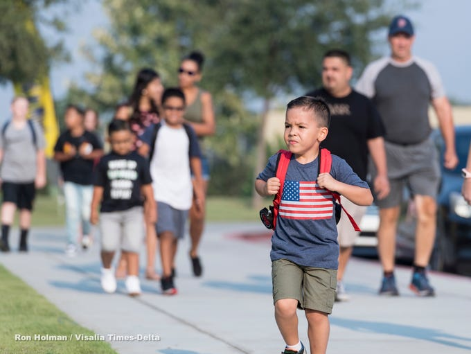 Caden Perez, 5, heads for his first day of kindergarten
