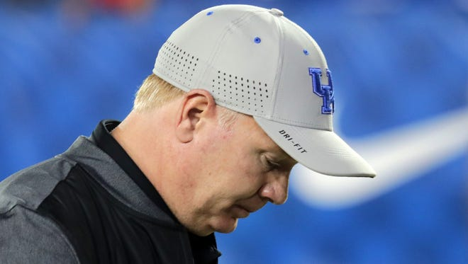 Kentucky's Mark Stoops leaves the field after the last minute loss to Ole Miss.