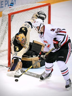 St. Cloud State's Patrick Russell tries unsuccessfully to slip the puck around Western Michigan goalie Lukas Hafner during the first period Saturday at the Herb Brooks National Hockey Center.