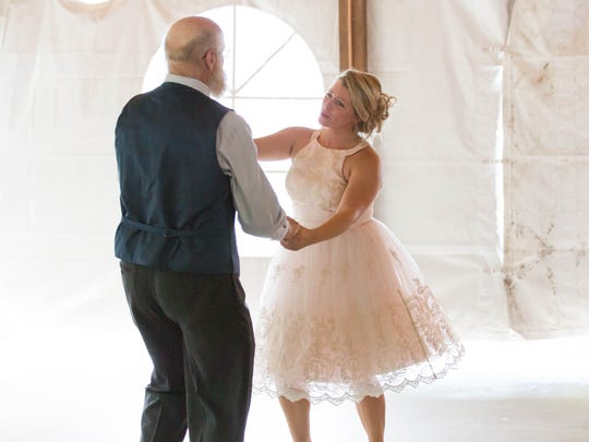 Erin Saddlemire VanNosdall and her father, Gary ''Bonz' Saddlemire, dance to Sheryl Crow's 'Soak Up the Sun' at her wedding.