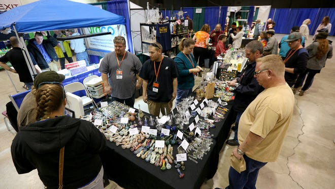 Visitors crowd the Starbuck Glass Designs booth during The Hemp and Cannabis Fair, Sunday, November 15, 2015, at the Oregon State Fairgrounds in Salem, Ore.