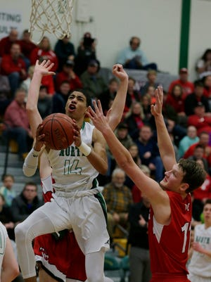 Oshkosh North's Tyrese Haliburton drives against Wisconsin Rapids during a March 3 regional final game in Oshkosh.