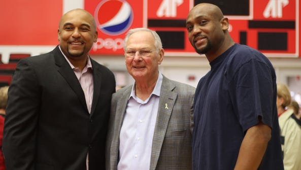 Retired Austin Peay coach Dave Loos, center, with former