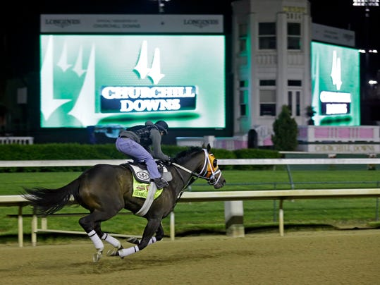 Exercise rider Joel Barrientos takes Kentucky Derby entrant General a Rod for a morning workout during a morning workout at Churchill Downs Friday, May 2, 2014, in Louisville, Ky. (AP Photo/Morry Gash)