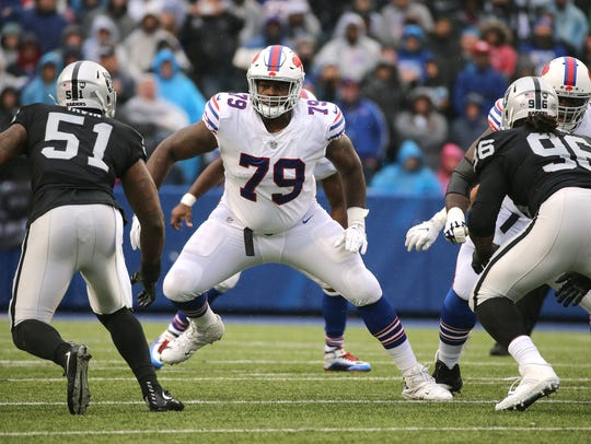 Bills Jordan Mills pass blocks against the Raiders.