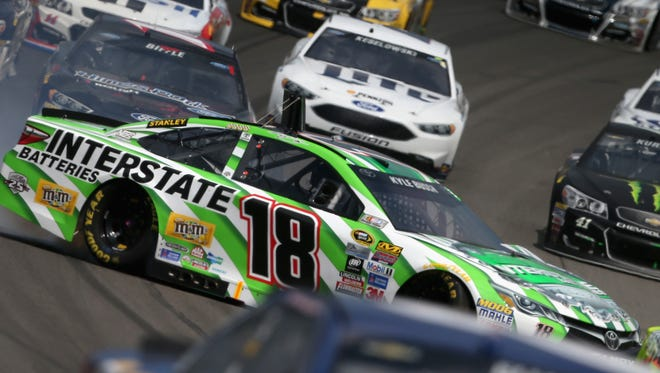 Kyle Busch, driver of the No. 18 Interstate Batteries Toyota, spins during the NASCAR Sprint Cup Series Pure Michigan 400 at Michigan International Speedway in Brooklyn on Aug. 28.