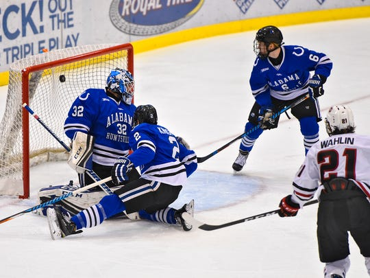 A shot by by St. Cloud State's Jake Wahlin gets past University of Alabama-Huntsville goaltender Jordan Uhelski during the first period of the Friday, Oct. 28, game at the Herb Brooks National Hockey Center in St. Cloud.