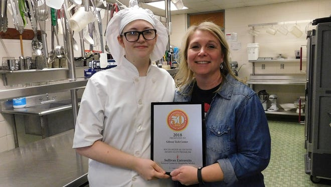 Culinary Arts student Cierra Woodall (left) and instructor Jennifer Noriega (right) show off Gibson Technical Center's Elite 50 Award.