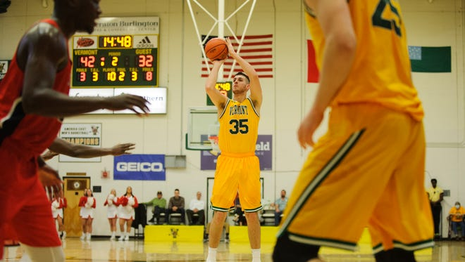 Vermont's Payton Henson (35) shoots a 3-pointer during the America East men's basketball semifinal game between the Stony Brook Seawolves and the Vermont Catamounts at Patrick Gym in March.