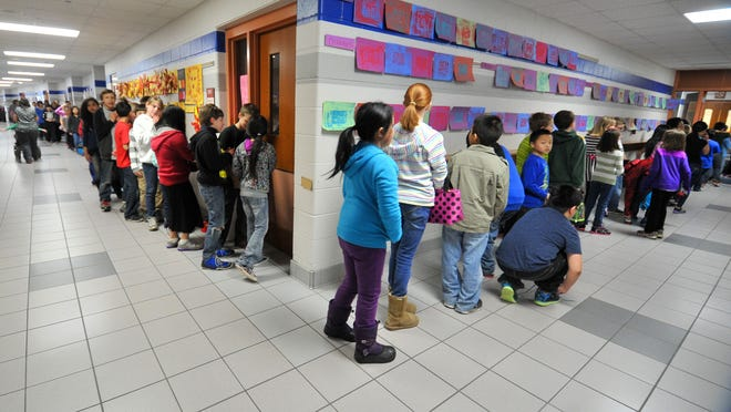 Students line up for lunch Wednesday afternoon, March 25, 2015, at Thomas Jefferson Elementary School in Wausau. If voters approve a Wausau School District building plan in an April 7 referendum, and additional four classrooms, a 4-K educational area and new cafeteria will be added to the school.